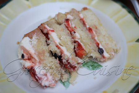 Four layer vanilla-berry cake