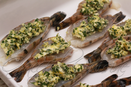 Parsley garlic butter on butterflied shrimp