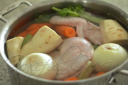 Combine chicken and vegetables in pot of water