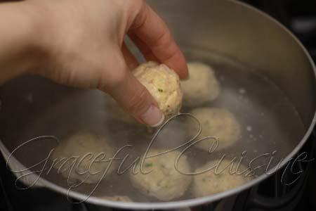 Boil matzo balls to cook