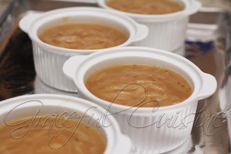 ladle soup into soup crocks