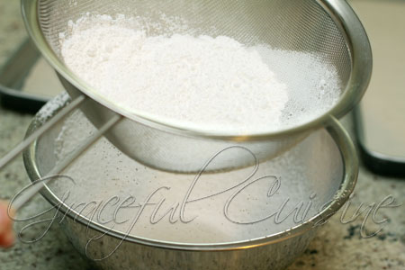 Sifting icing sugar