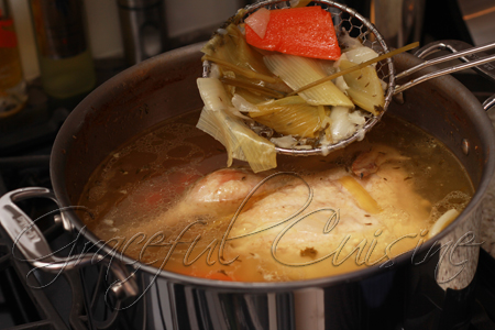 Straining homemade chicken broth