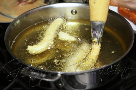 pipe batter into hot oil
