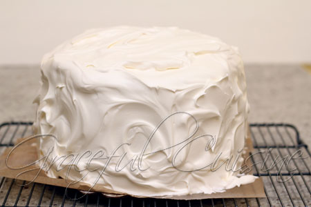 thick coating of Nutriwhip all over sides of cake