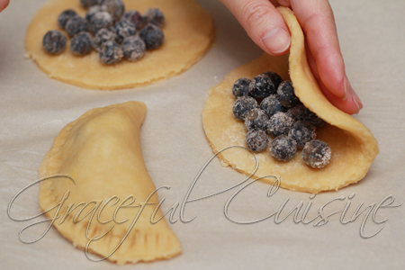 fold turnover dough over blueberry filling