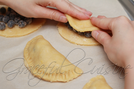 fold pastry dough over in half moon shape