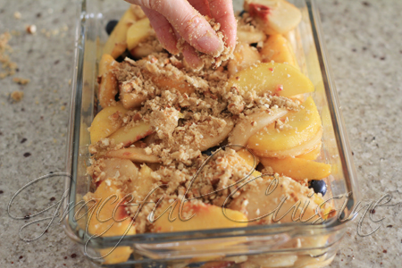 topping on peach cobbler with blueberries