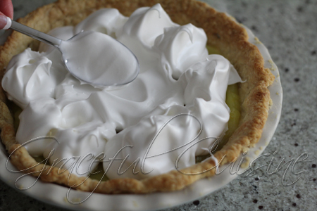 spread dollops of meringue around pie
